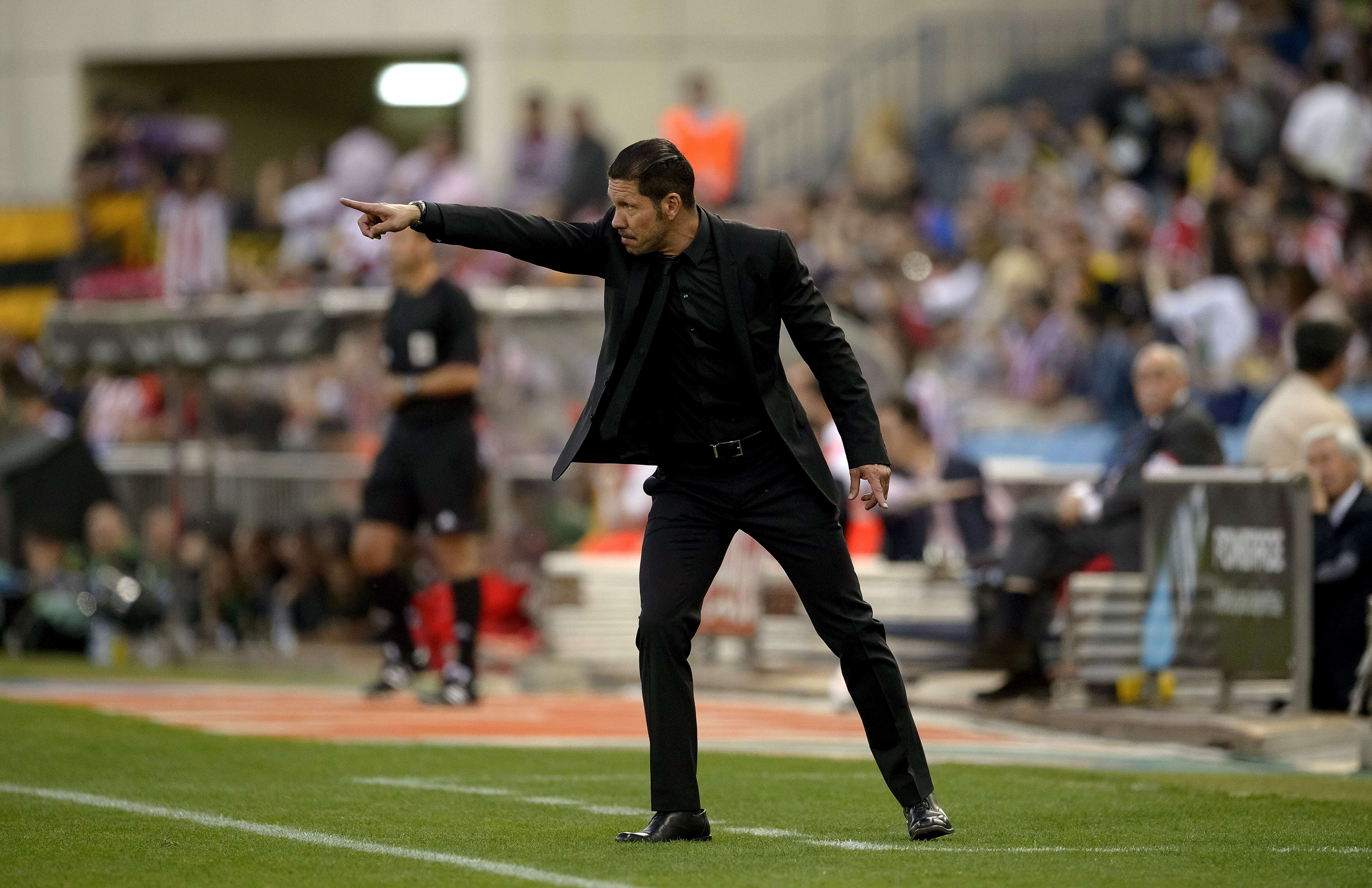 Atletico Madrid's Argentinian coach Diego Simeone gestures during the Spanish league football match Club Atletico de Madrid vs Elche CF at the Vicente Calderon stadium in Madrid on April 18, 2014. AFP PHOTO/ DANI POZODANI POZO/AFP/Getty Images@@DV1707650.jpg