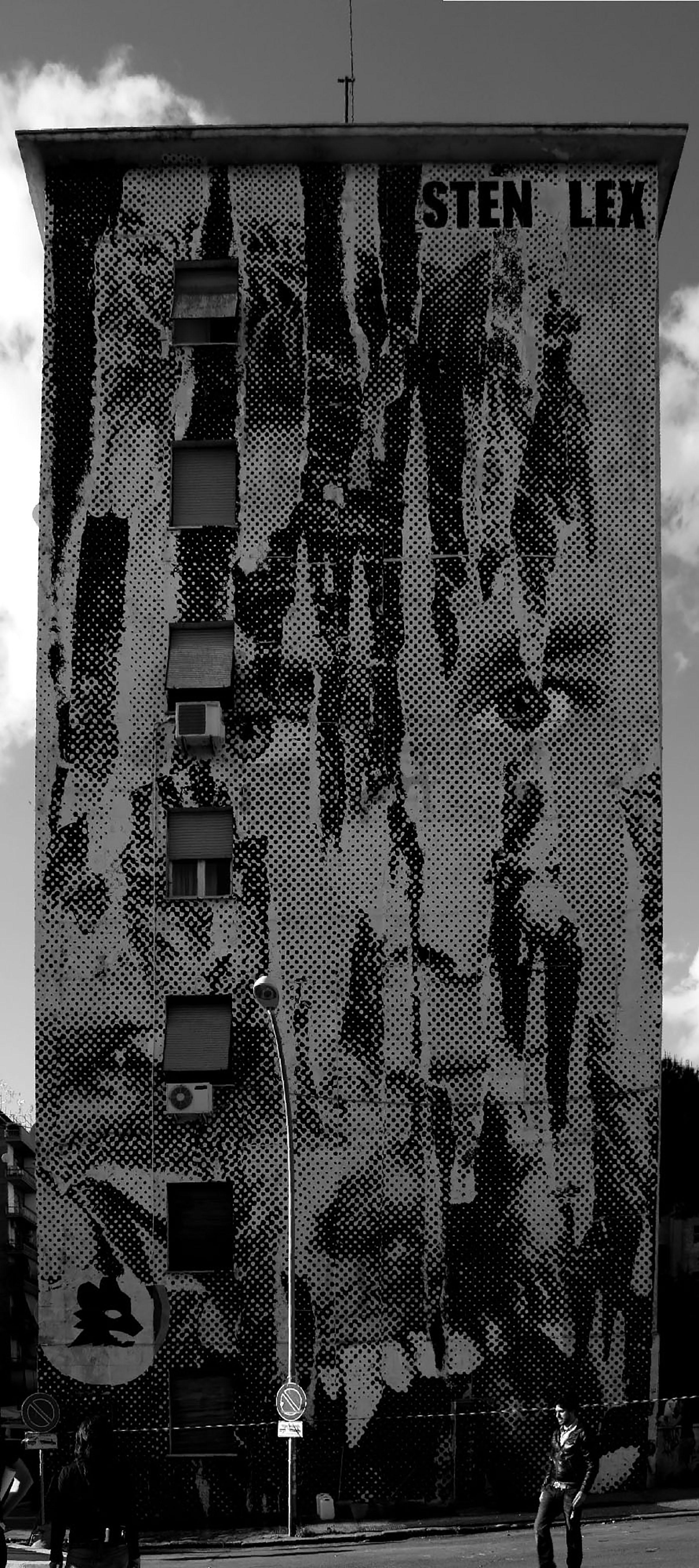 Sten - Lex. Poster temporaneo su parete nel quartiere Garbatella a Roma. 2010