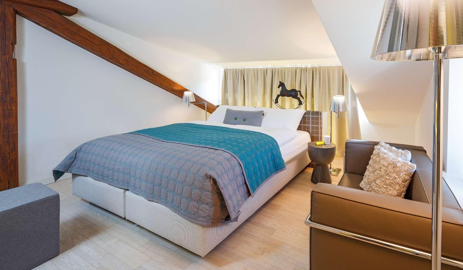 csm_Hotel_Roessli_Zuerich_Schweiz_JuniorSuite_Bett_boxspring_1ca04d7b60