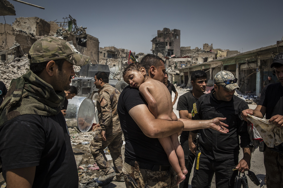 Ivor Prickett, The Battle for Mosul - Young Boy Is Cared for by Iraqi Special Forces Soldiers